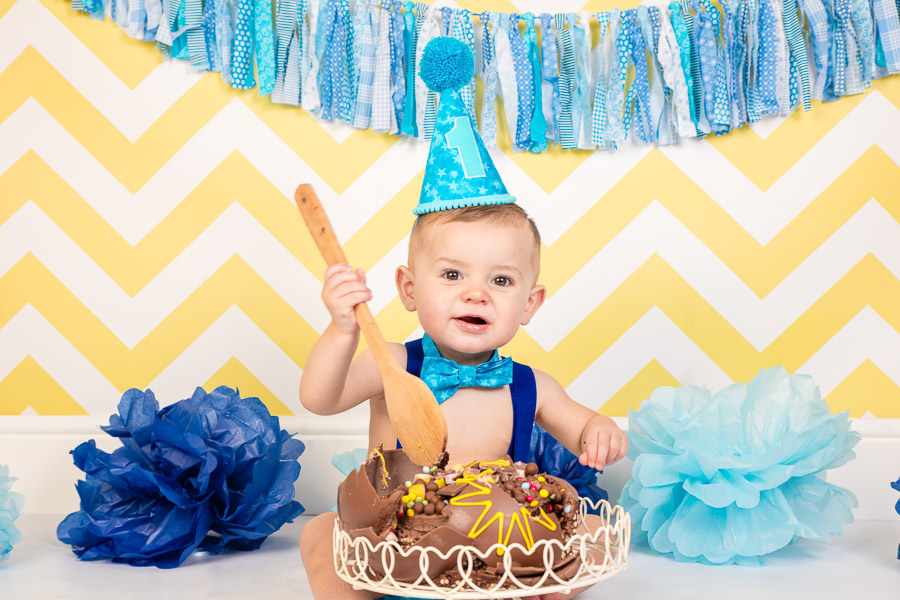 Large wooden spoon and cake