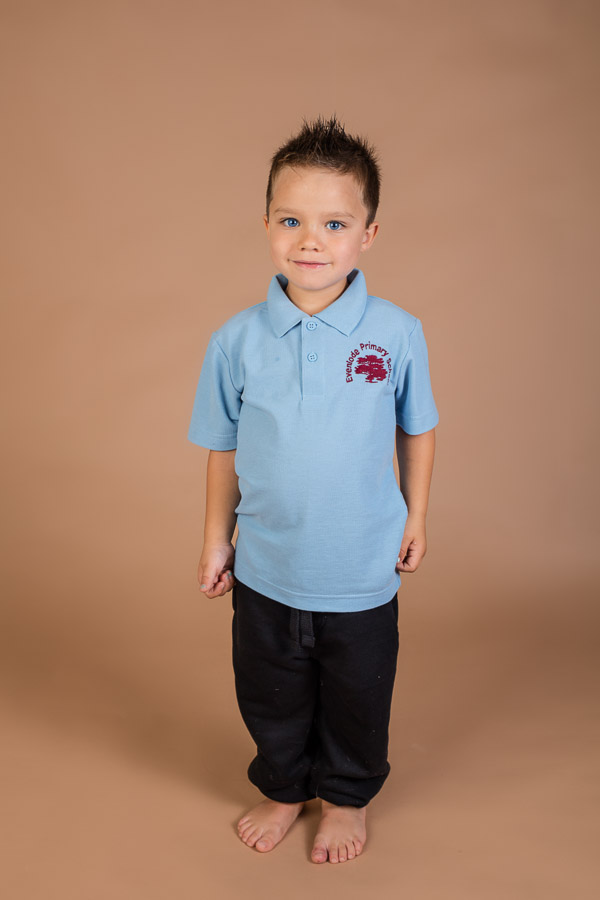 boy standing in his school uniform