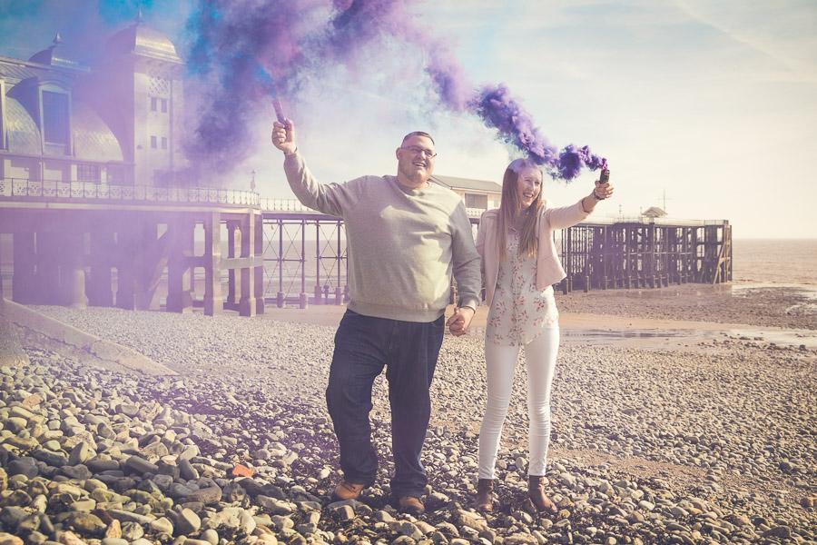 a man and a woman stood on penarth beach
